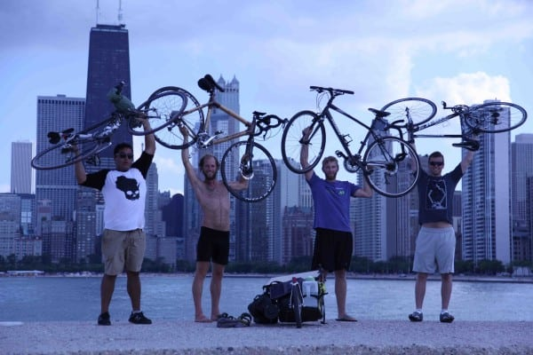 Rob Greenfield and 3 fellow cyclists celebrate their arrival in Chicago.
