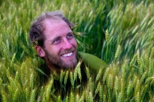 Photo of Rob Greenfield in a field