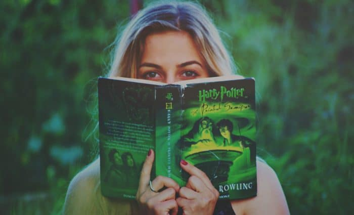 Photo of woman reading a Harry Potter book shows the power of storytelling.